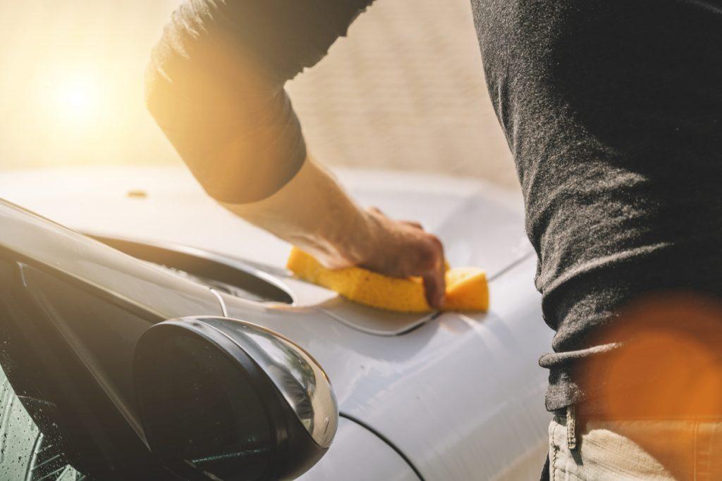 Man holding sponge for car wash