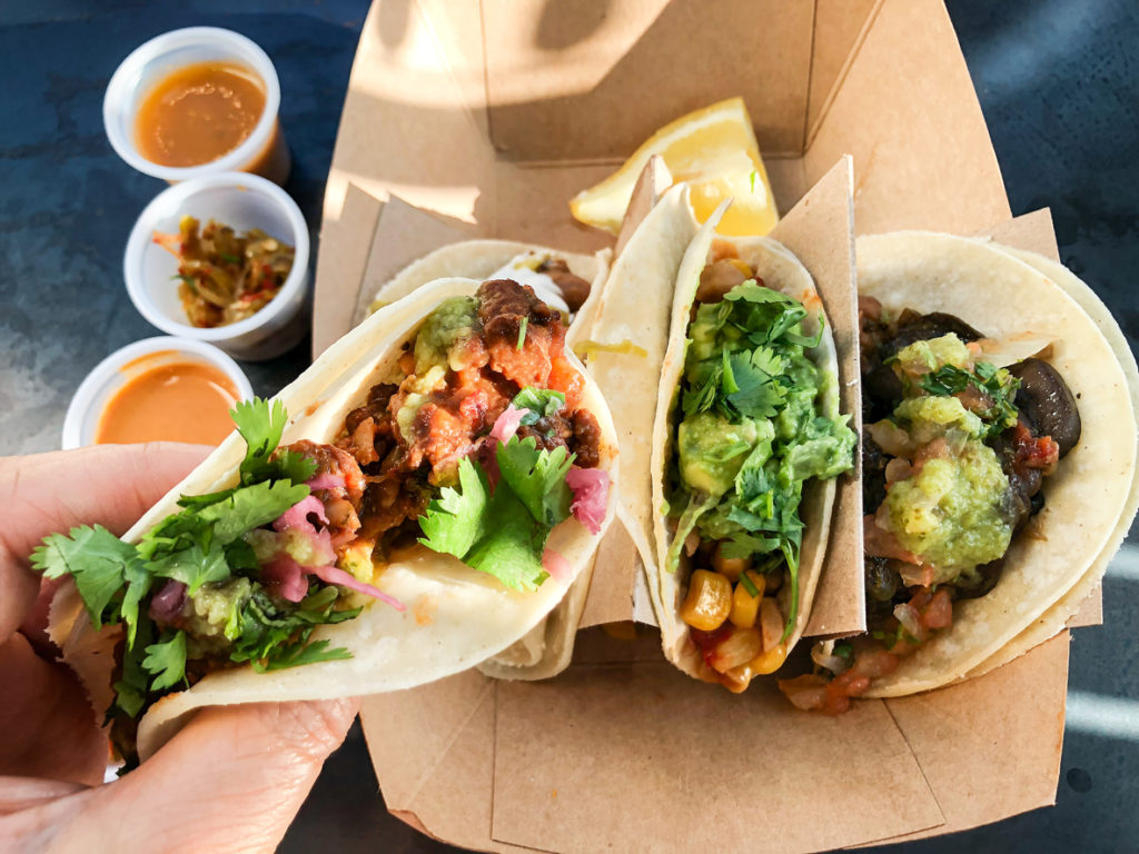 Three tacos in a delivery container