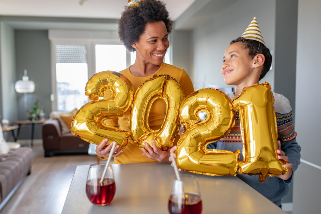 Mother and son celebrating New Year 2021 at home