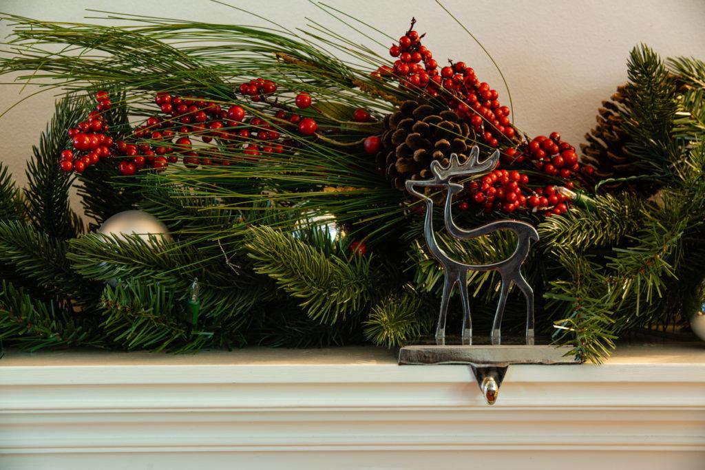 Christmas fireplace hanger reindeer with green garland cherry and bauballs