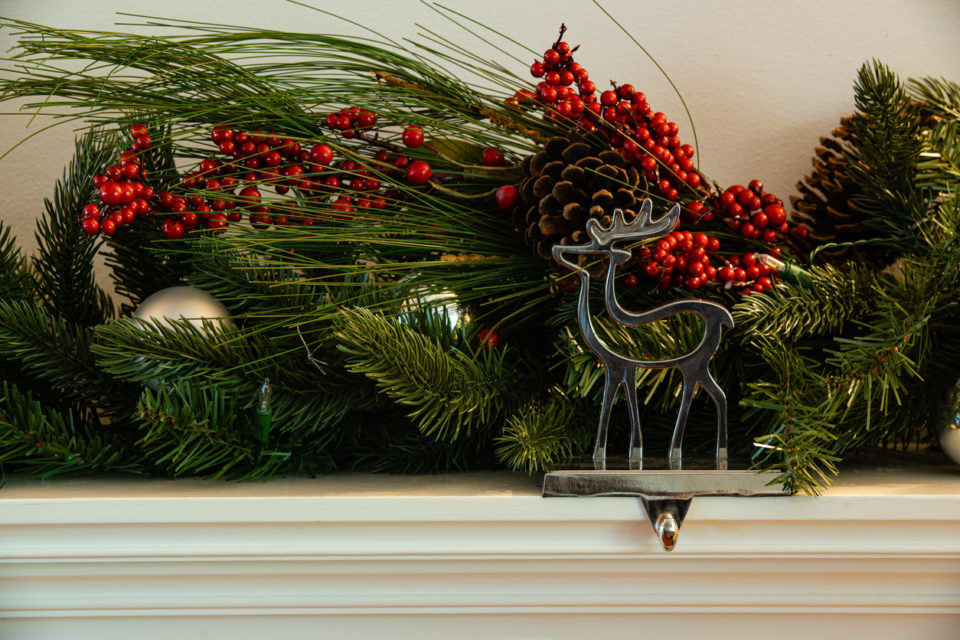 Christmas fireplace hanger reindeer with green garland cherry and bauballs