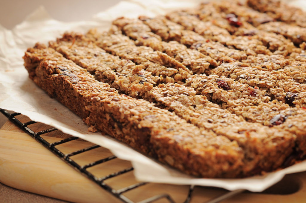 Granola bars, cut on parchment, delicious and healthy snack!