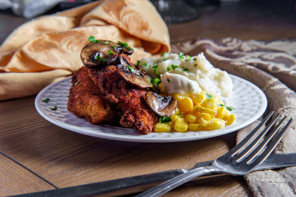 Crispy breaded chicken marsala with mashed potatoes and kernel corn