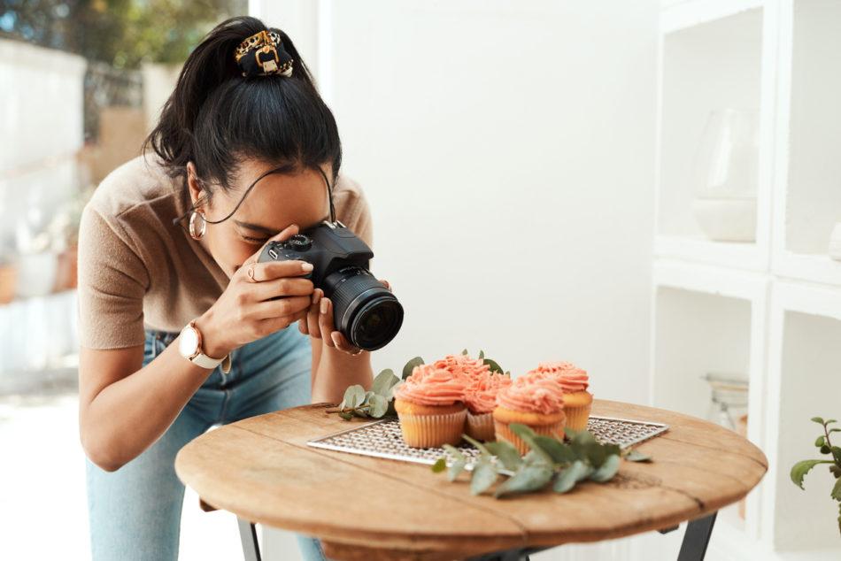 Photographer capturing photo of cupcakes