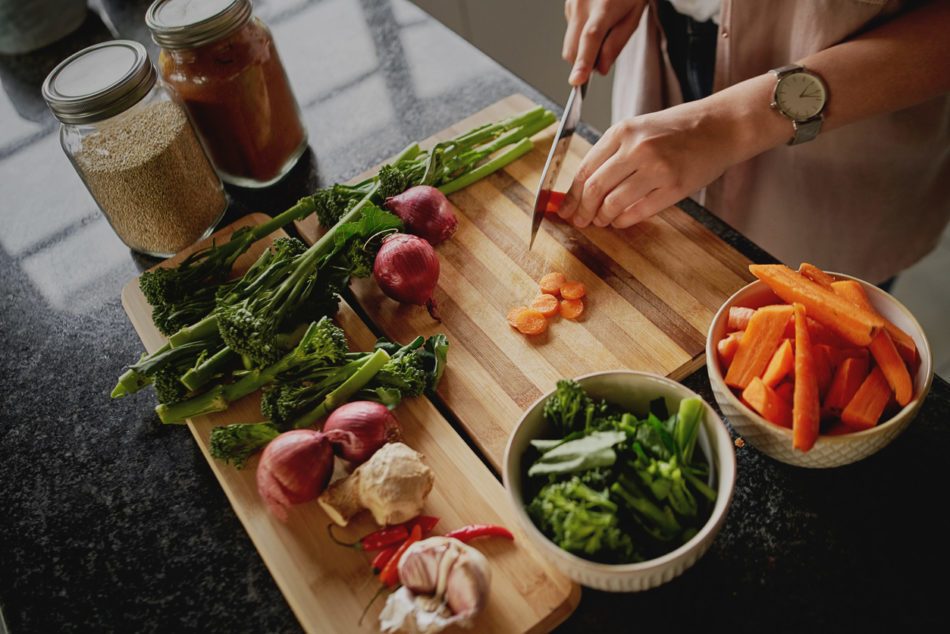 Female hands cutting vegetables