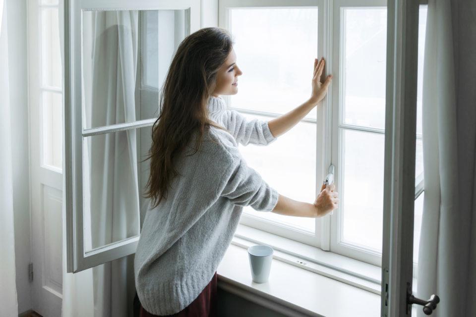 woman sealing the window