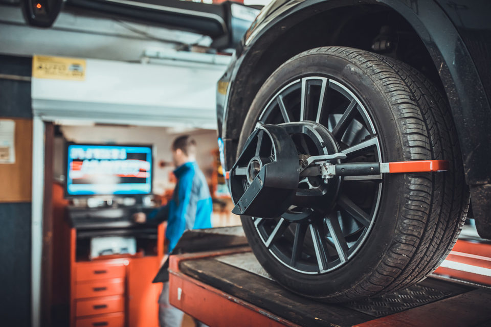 Wheel alignment equipment on a car wheel in a repair station